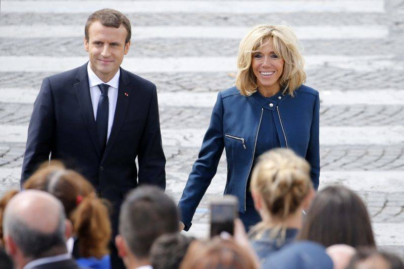 PARIS, FRANCE - JULY 14:  French President Emmanuel Macron and his wife Brigitte Trogneux attend the traditional Bastille day military parade on the Champs-Elysees on July 14, 2017 in Paris France. Bastille Day, the French National day commemorates this year the 100th anniversary of the entry of the United States of America into World War I.  (Photo by Thierry Chesnot/Getty Images)