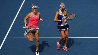 NEW YORK, NY - SEPTEMBER 07:  Timea Babos of Hungary and Andrea Hlavackova of the Czech Republic react against Sania Mirza of India and Shuai Peng of China during their Women's Doubles Fourth Round match on Day Eleven of the 2017 US Open at the USTA Billie Jean King National Tennis Center on September 7, 2017 in the Flushing neighborhood of the Queens borough of New York City.  (Photo by Elsa/Getty Images)