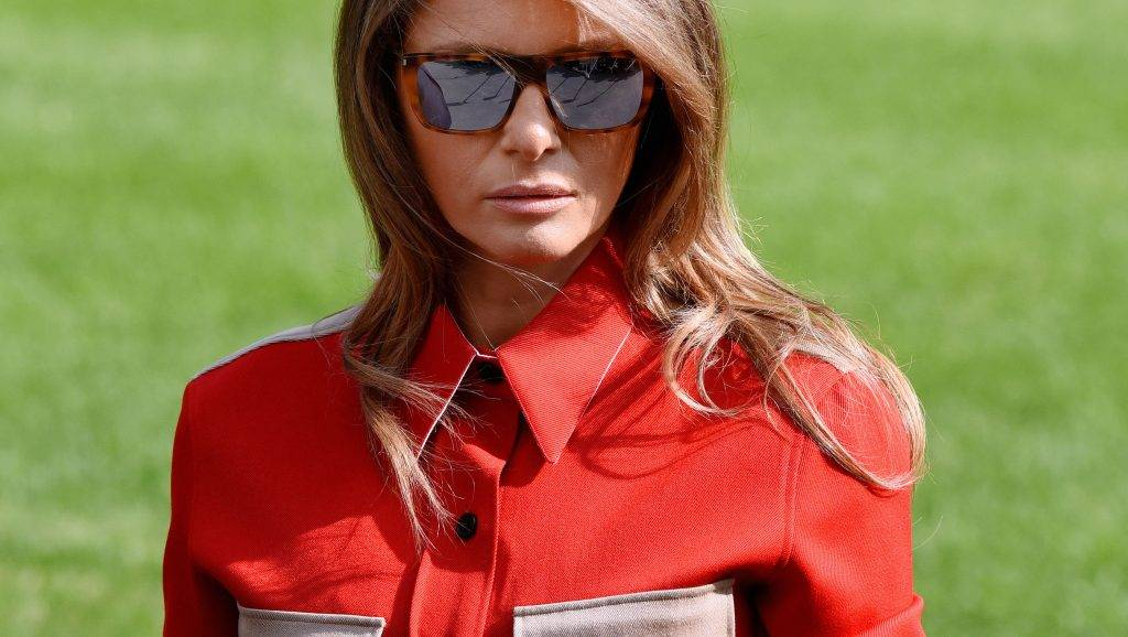 WASHINGTON, DC - SEPTEMBER 10:  (AFP OUT) First Lady Melania Trump looks as US President Donald Trump talks to members of the media about hurricane Irma upon arrival on the South Lawn of the White House September 10, 2017 in Washington, DC  Trump spent the weekend at Camp David, the Presidential retreat in Maryland. (Photo by Olivier Douliery-Pool/Getty Images)