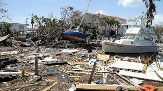 MARATHON, FL - SEPTEMBER 12:  Boats, cars and other debris clog waterways in the Florida Keys two days after Hurricane Irma slammed into the state on September 12, 2017 in Marathon, Florida. The Federal Emergency Managment Agency has reported that 25-percent of all homes in the Florida Keys were destroyed and 65-percent sustained major damage when they took a direct hit from Hurricane Irma.  (Photo by Chip Somodevilla/Getty Images)