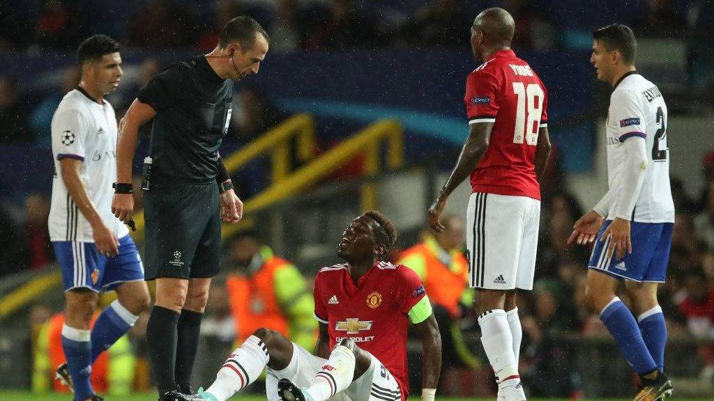 MANCHESTER, ENGLAND - SEPTEMBER 12: Paul Pogba of Manchester United down injured during the UEFA Champions League match between Manchester United and FC Basel at Old Trafford on September 12, 2017 in Manchester, England. (Photo by Robbie Jay Barratt - AMA/Getty Images)