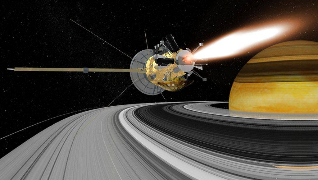 An artist rendering of the Cassini spacecraft entering orbit around Saturn. The two-story, $3.4 billion spacecraft carrying a load of deadly plutonium will zoom within 725 miles of Earth August 17, 1999 to gain momentum for the final leg of its meandering, seven-year voyage to Saturn. Cassini's return, two years after NASA launched the largest and most expensive unmanned spacecraft ever, poses virtually no risk, mission officials say. The probe will approach Earth at about 35,000 mph. Its speed will increase by about 11,000 mph after the swingby. (NASA)