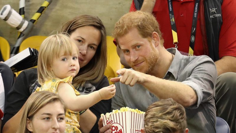 TORONTO, ON - SEPTEMBER 27: Hayley Henson and daughter Emily Henson sit with Prince Harry at the Sitting Volleyball Finals during the Invictus Games 2017 at Mattamy Athletic Centre on September 27, 2017 in Toronto, Canada.   Chris Jackson/Getty Images for the Invictus Games Foundation/AFP