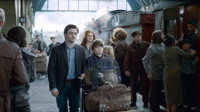 """SUNDAY CALENDAR AUGUST 7, 2011. DO NOT USE PRIOR TO PUBLICATION ******************** (L-r from center) DANIEL RADCLIFFE as Harry Potter, BONNIE WRIGHT as Ginny Weasley and ARTHUR BOWEN as Albus Severus Potter (19 years later)  in Warner Bros. Pictures' fantasy adventure movie  """"HARRY POTTER AND THE DEATHLY HALLOWS - PART 2,"""" a Warner Bros. Pictures release. Photo courtesy of Warner Bros. Pictures"""