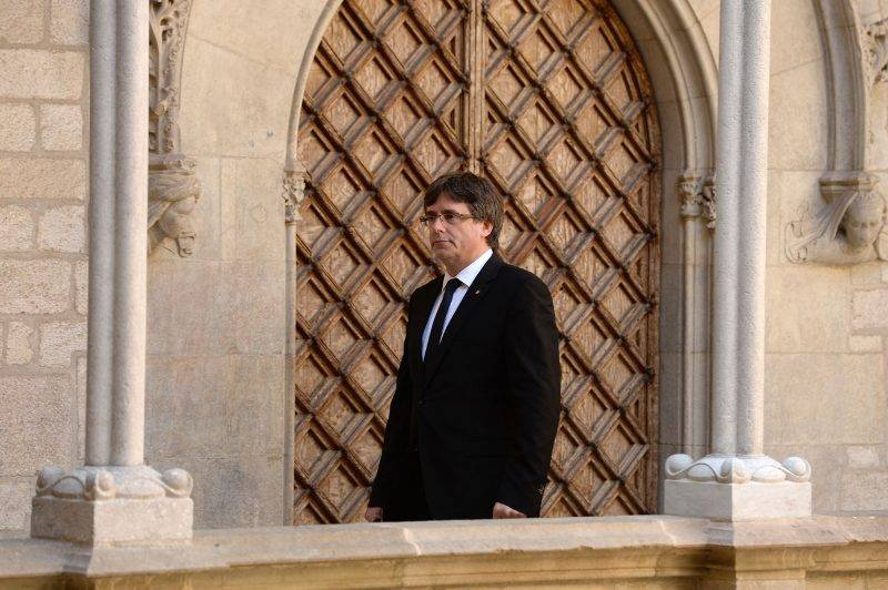 Catalan regional president Carles Puigdemont arrives to give a speech in Barcelona on September 20, 2017.Spanish police detained 13 Catalan government officials as they continued to crack down on preparations for an independence referendum in the region which Madrid says is illegal, sparking angry protests in Barcelona. The operation comes amid mounting tensions as Catalan leaders press ahead with preparations for an independence referendum on October 1 despite Madrid's ban and a court ruling deeming it unconstitutional. / AFP PHOTO / Josep LAGO
