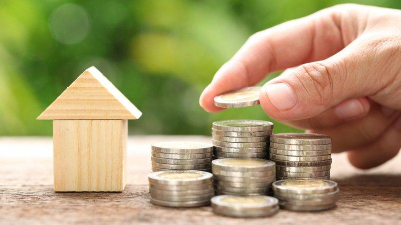 House and coins stack. The concept of purchase of habitation, buy a house