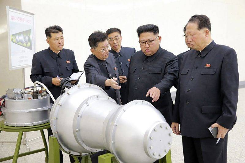 (FILES) This undated file photo released by North Korea's official Korean Central News Agency (KCNA) on September 3, 2017 shows North Korean leader Kim Jong-Un (C) looking at a metal casing with two bulges at an undisclosed location.