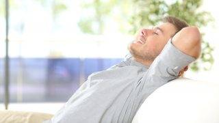 Man resting and breathing at home