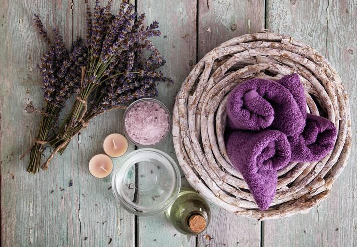 Spa and wellness setting with lavender flowers; floral water and bath salt. Dayspa nature set;