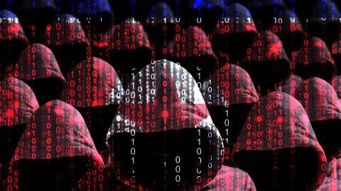 Group of hooded hackers shining through a digital north korean flag cybersecurity concept