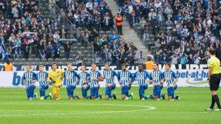 Hertha Berlin's players knee on the pitch prior to the German First division Bundesliga football match Hertha BSC Berlin vs Schalke 04 in Berlin on October 14, 2017. Hertha Berlin players became the latest prominent sportsmen to follow the lead of NFL star Colin Kaepernick and 'take a knee' in an act of political protest. Kneeling has come to symbolise protest against the politics of Donald Trump since the US president's public dispute with Kaepernick and other prominent figures in American sport. / AFP PHOTO / DPA / Annegret Hilse / Germany OUT / RESTRICTIONS: DURING MATCH TIME: DFL RULES TO LIMIT THE ONLINE USAGE TO 15 PICTURES PER MATCH AND FORBID IMAGE SEQUENCES TO SIMULATE VIDEO. == RESTRICTED TO EDITORIAL USE == FOR FURTHER QUERIES PLEASE CONTACT DFL DIRECTLY AT + 49 69 650050