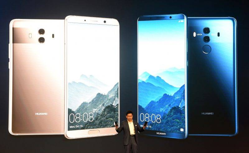 Richard Yu, CEO of Chinese Huawei Consumer Business Group, presents the new Huawei Mate 10 high-end smartphone in Munich, southern Germany, on October 16, 2017. Chinese technology group Huawei unveiled its latest smartphone, talking up the advanced artificial intelligence capabilities it hopes will cement its place among the world's three biggest manufacturers. / AFP PHOTO / Christof STACHE