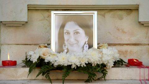 Flowers and tributes lay at the foot of the Great Siege monument in Valletta, Malta, on October 19, 2017 which has been turned into a temporary shrine for Maltese journalist and blogger Daphne Caruana Galizia (picture) who was killed by a car bomb outside her home in Bidnjia, Malta, on October 16, 2017. / AFP PHOTO / Matthew Mirabelli
