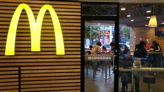--FILE--Chinese customers eat food at a fastfood restaurant of McDonald's in Yichang city, central China's Hubei province, 8 March 2016.A customer at a fast food chain southwest China suffered organ damage after drinking hot beverage that contained disinfectant, according to a local newspaper. The customer, identified by his last name Feng, had ordered a child's lunch his four-year-old son at a McDonalds outlet in Chongqing on Monday, the Chongqing Evening News reported. After taking a sip of a cup of hot chocolate that came with the set, the boy stuck out his tongue, shook his head, and refused to finish the rest of the drink, Feng said. But when his son finished his meal, he left the drink untouched. He took a big swig of the drink, which tasted sour, and thought someone may have added lemonade to it by mistake. When he took showed what remained of the drink to the staff and asked them what was wrong with it, he was astonished to learn that disinfectant had been added in the cup. They explained that when Feng ordered his meal, they had just started their disinfecting the kitchen. One of the staff had poured disinfectant into a boiler to clean it, and a colleague used the water to make the drink, without knowing it was contaminated. Feng had his stomach pumped at hospital but was told that his liver and stomach may be damaged.