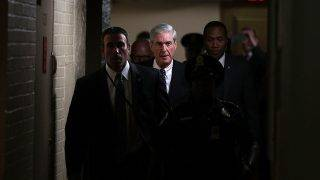 WASHINGTON, DC - JUNE 21: Special counsel Robert Mueller (C) leaves after a closed meeting with members of the Senate Judiciary Committee June 21, 2017 at the Capitol in Washington, DC. The committee meets with Mueller to discuss the firing of former FBI Director James Comey.   Alex Wong/Getty Images/AFP