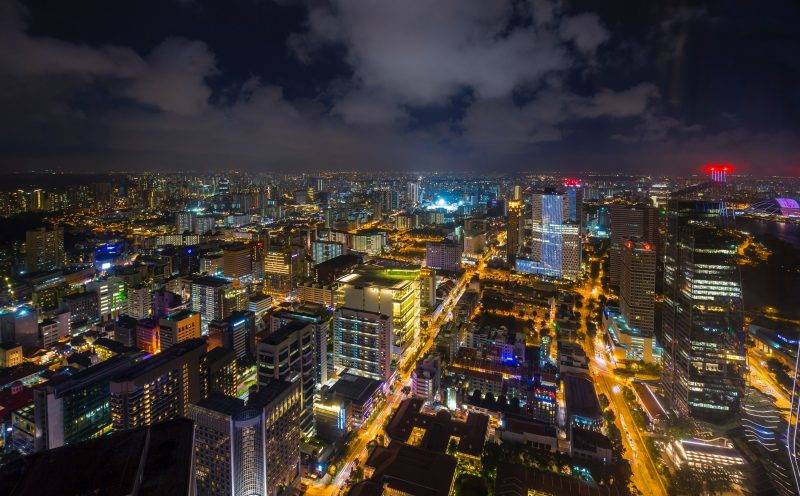 High angle cityscape and city lights at night, Singapore, South East Asia