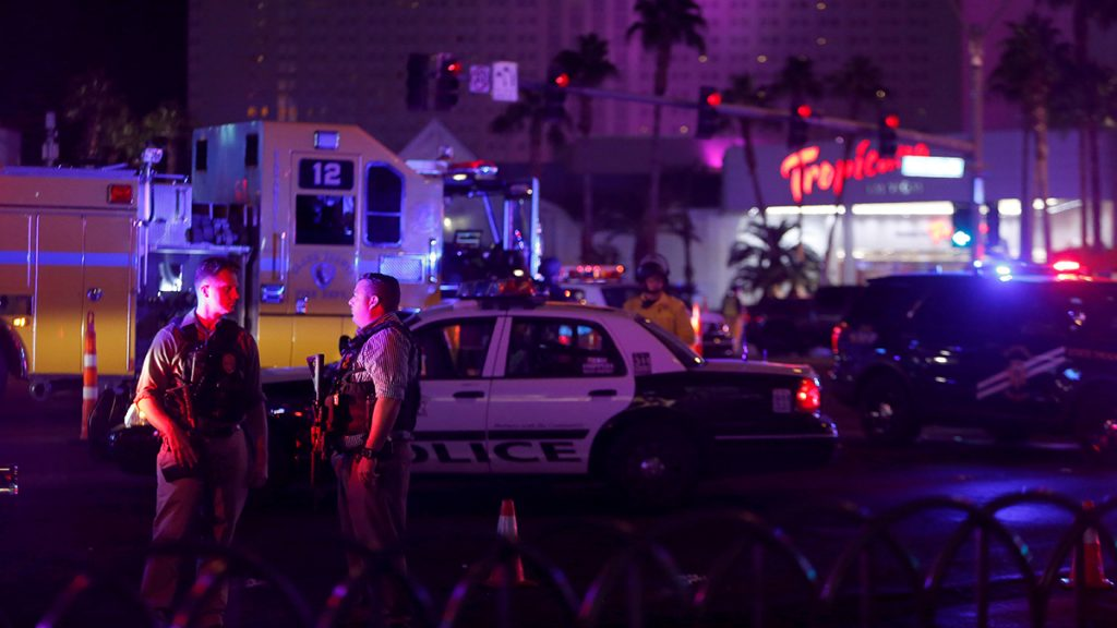 Las Vegas Metro Police officers confer near a staging area in the intersection of Tropicana Avenue and Las Vegas Boulevard South after a mass shooting at a music festival on the Las Vegas Strip in Las Vegas, Nevada, U.S. early October 2, 2017. REUTERS/Las Vegas Sun/Steve Marcus