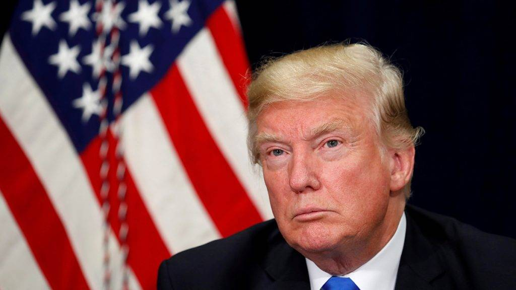 FILE PHOTO: U.S. President Donald Trump listens during a briefing on hurricane Harvey recovery efforts in Dallas, Texas, U.S, October 25, 2017. REUTERS/Kevin Lamarque/File Photo