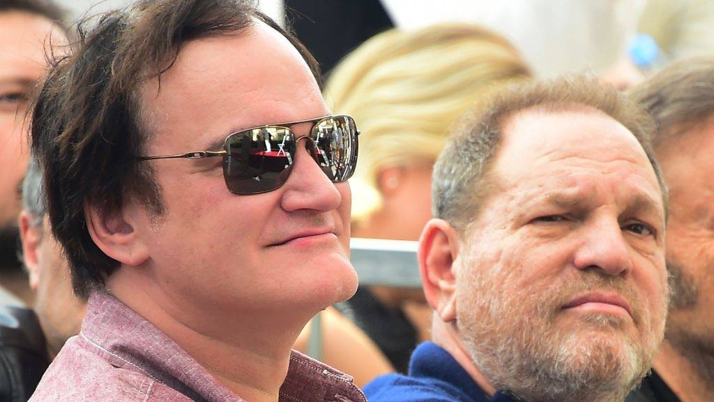 Film director Quentin Tarantino and producer Harvey Weinstein attend Italian composer Ennio Morricone's  Hollywood Walk of Fame Star ceremony on February 26, 2016 in Hollywood, California. Morricone received the 2,574th Star on the walk of fame in the category of Live Performance/Theater. / AFP PHOTO / FREDERIC J. BROWN