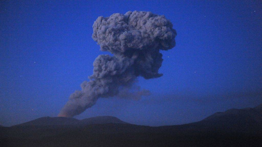 """A plume of smoke rises from the crater of Mount Shinmoedake in the Kirishima mountain range of Kagoshima prefecture on Japan's southern island of Kyushu on February 7, 2011.  A series of spectacular eruptions from a volcano in southern Japan fired columns of ash and smoke thousands of metres in the air early Wednesday, with the cloud delaying some international flights to Tokyo.  The 1,421-metre (4,689-feet) Shinmoedake volcano in the Kirishima range, featured in the 1967 James Bond film """"You Only Live Twice"""", continued the series of deafening blasts which began with the start of its first major eruption for 52 years last week.  AFP PHOTO / KAZUHIRO NOGI / AFP PHOTO / KAZUHIRO NOGI"""