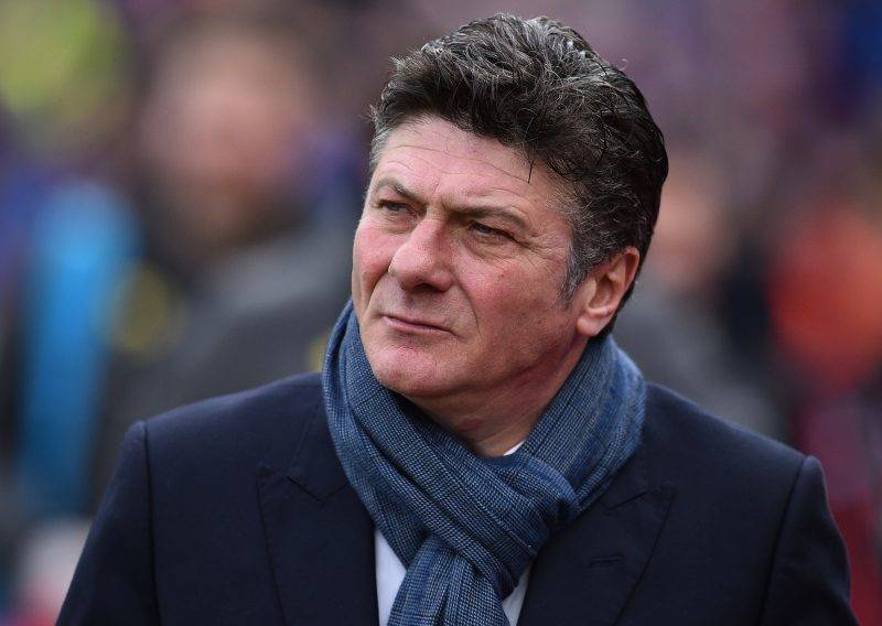 Watford's Italian head coach Walter Mazzarri arrives for the English Premier League football match between Crystal Palace and Watford at Selhurst Park in south London on March 18, 2017. / AFP PHOTO / Glyn KIRK / RESTRICTED TO EDITORIAL USE. No use with unauthorized audio, video, data, fixture lists, club/league logos or 'live' services. Online in-match use limited to 75 images, no video emulation. No use in betting, games or single club/league/player publications.  /