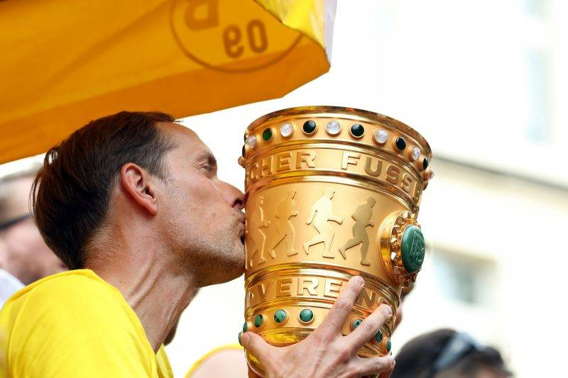 Dortmund's head coach Thomas Tuchel kisses the trophy as he and his players arrive at Borsigplatz during celebrations after winning the German Cup final (DFB Pokalfinale) in Dortmund, western Germany, on May 28, 2017. / AFP PHOTO / dpa / Friso Gentsch / Germany OUT
