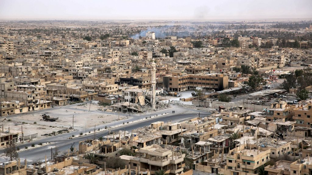 A picture taken from a helicopter during a press tour provided by the Russian Armed Forces on September 15, 2017 shows an aerial view of the modern city of Palmyra, in Syria's central province of Homs. / AFP PHOTO / France2 / Dominique DERDA