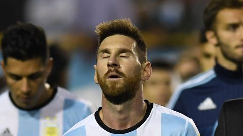 Argentina's Lionel Messi gestures at the end of their 2018 World Cup football qualifier match against Peru, in Buenos Aires on October 5, 2017. / AFP PHOTO / EITAN ABRAMOVICH