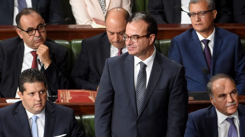 (FILES) This file photo taken on September 11, 2017 shows Tunisian health minister Slim Chaker (C) attending a parliamentary session in Tunis. Chaker, 56, died on October 8, 2017 after suffering a heart attack during a marathon organized for the benefit of a cancer-fighting association, the ministry said. / AFP PHOTO / FETHI BELAID