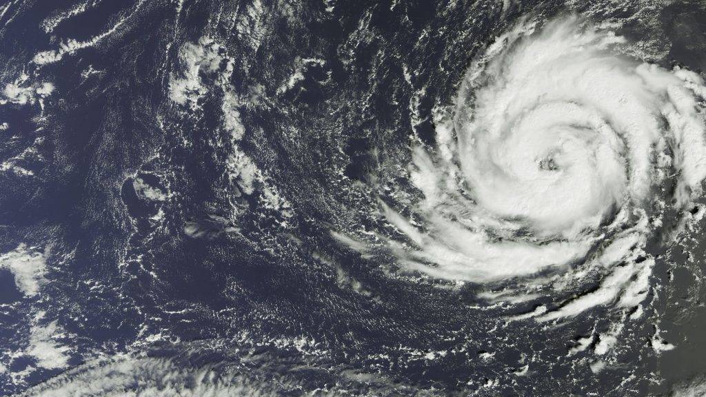 """A handout satellite image captured by the The Copernicus Sentinel-3A satellite's OLCI instrument on October 11, 2017 and released by the European Space Agency (ESA) on Octob er 15, 2017 shows Hurricane Ophelia over the Atlantic Ocean about 1300 km southwest of the Azores islands. Hurricane Ophelia strengthened to a Category 3 storm as it passed near the Portuguese Azores archipelago on Octoer 14 on route for Ireland. Five counties in the west of Ireland will be placed on red alert for """"severe"""" weather conditions from October 16 morning to early October 17, the Irish Meteorological Service said. / AFP PHOTO / EUROPEAN SPACE AGENCY / - / RESTRICTED TO EDITORIAL USE - MANDATORY CREDIT """"AFP PHOTO / ESA """" - NO MARKETING NO ADVERTISING CAMPAIGNS - DISTRIBUTED AS A SERVICE TO CLIENTS"""