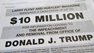"""A photo taken on October 15, 2017 in in Washington, DC shows a full-page newspaper advertisement in the Washington Post offering 10 million dollars from Hustler Magazine publisher Larry Flynt for information leading to the impeachment and removal from office of US President Donald Trump.  """"I do not expect any of Trump's billionaire cronies to rat him out, but I am confident that there are many people in the know for whom $10 million is a lot of money,"""" Flynt said in the ad. The porn magazine founder noted that he had used million dollar cash rewards before to elicit information that helped upend the careers of two Republican politicians. / AFP PHOTO / SAUL LOEB"""