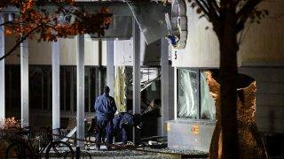 Police forensics work outside the police station in Helsingborg, on October 18, 2017, after a powerful explosion occured at the main entrance.        Nobody was injured in the explosion, which occurred shortly after midnight local time and also shattered windows in a neighboring building, police said in a statement. / AFP PHOTO / TT News Agency / Johan NILSSON / Sweden OUT