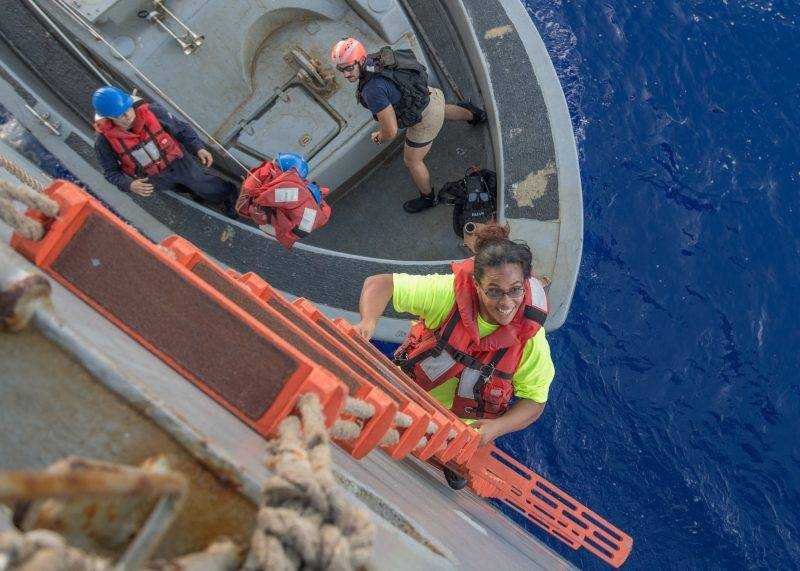 "This US Navy photo released October 26, 2017 shows Tasha Fuiaba, an American mariner who had been sailing for five months on a damaged sailboat,as she climbs the accommodation ladder to board the amphibious dock landing ship USS Ashland (LSD 48) on October 25, 2017 in the Pacific Ocean.  Ashland, operating in the Indo-Asia-Pacific region on a routine deployment, rescued two American mariners who had been in distress for several months after their sailboat had a motor failure and had strayed well off its original course while traversing the Pacific Ocean.  / AFP PHOTO / U.S. Navy / Jonathan CLAY / RESTRICTED TO EDITORIAL USE - MANDATORY CREDIT ""AFP PHOTO / US NAVY/JONATHAN CLAY/HANDOUT"" - NO MARKETING NO ADVERTISING CAMPAIGNS - DISTRIBUTED AS A SERVICE TO CLIENTS"