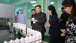 "This undated picture released from North Korea's official Korean Central News Agency (KCNA) on October 29, 2017 shows North Korean leader Kim Jong-Un (C) inspecting the Pyongyang Cosmetics Factory, as his wife Ri Sol-Ju (R) looks on. / AFP PHOTO / KCNA VIA KNS / STR / South Korea OUT / REPUBLIC OF KOREA OUT   ---EDITORS NOTE--- RESTRICTED TO EDITORIAL USE - MANDATORY CREDIT ""AFP PHOTO/KCNA VIA KNS"" - NO MARKETING NO ADVERTISING CAMPAIGNS - DISTRIBUTED AS A SERVICE TO CLIENTS THIS PICTURE WAS MADE AVAILABLE BY A THIRD PARTY. AFP CAN NOT INDEPENDENTLY VERIFY THE AUTHENTICITY, LOCATION, DATE AND CONTENT OF THIS IMAGE. THIS PHOTO IS DISTRIBUTED EXACTLY AS RECEIVED BY AFP.  /"