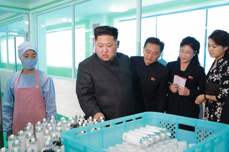"This undated picture released from North Korea's official Korean Central News Agency (KCNA) on October 29, 2017 shows North Korean leader Kim Jong-Un (2nd L) inspecting the Pyongyang Cosmetics Factory, as his wife Ri Sol-Ju (R) looks on. / AFP PHOTO / KCNA VIA KNS / STR / South Korea OUT / REPUBLIC OF KOREA OUT   ---EDITORS NOTE--- RESTRICTED TO EDITORIAL USE - MANDATORY CREDIT ""AFP PHOTO/KCNA VIA KNS"" - NO MARKETING NO ADVERTISING CAMPAIGNS - DISTRIBUTED AS A SERVICE TO CLIENTS THIS PICTURE WAS MADE AVAILABLE BY A THIRD PARTY. AFP CAN NOT INDEPENDENTLY VERIFY THE AUTHENTICITY, LOCATION, DATE AND CONTENT OF THIS IMAGE. THIS PHOTO IS DISTRIBUTED EXACTLY AS RECEIVED BY AFP.  /"