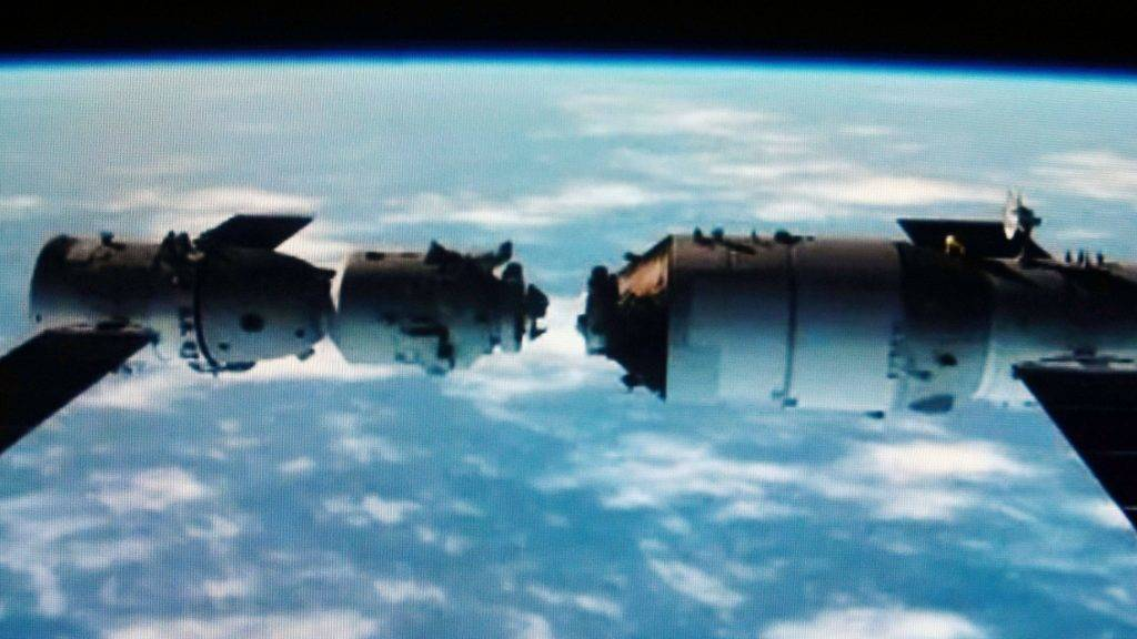 This TV grab taken on 2 November 2011 shows an animated video clip of the docking of the Tiangong-1 space lab module and the Shenzhou VIII (Shenzhou-8) spacecraft in space.  China successfully carried out its first docking exercise on Thursday (3 November 2011) between two unmanned spacecraft, a key test of the rising powers plans to secure a long-term manned foothold in space. The Shenzhou-8 spacecraft joined the Tiangong (Heavenly Palace) 1 module about 340 km above Earth, in a maneuver carried live on state television.