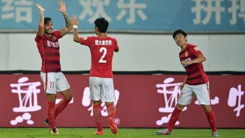 Brazilian football player Ricardo Goulart, left, of Guangzhou Evergrande celebrates with his teammates after scoring against Guizhou Hengfeng Zhicheng in the 28th round match during the 2017 Chinese Football Association Super League (CSL) in Guangzhou city, south China's Guangdong province, 22 October 2017.