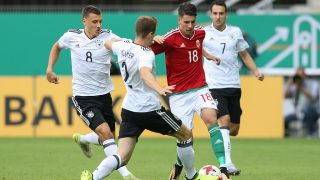 Germany's Lukas Kluenter (2-L) and Hungary's Dominik Szoboszlai (2-R)vie for the ball during the Under 21 test match between Germany and Hungary in the Benteler Arena in Paderborn, Germany, 01 September 2017. Photo: Friso Gentsch/dpa