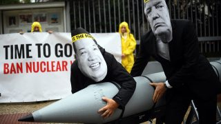 Activists of the International Campaign to Abolish Nuclear Weapons (ICAN) protest against the conflict between North Korea and the USA  with masks of the North Korean ruler Jong-un (L) and the US president Trump in front of the North Korean embassy in Berlin, Germany, 13 September 2017. Photo: Britta Pedersen/dpa-Zentralbild/ZB