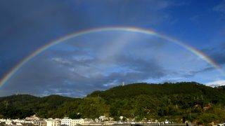 (171016) -- PU'ER, Oct. 16, 2017 (Xinhua) -- Photo taken on Oct. 15, 2017 shows a rainbow across the sky in Hani and Yi Autonomous County of Ning'er, Pu'er City, southwest China's Yunnan Province. Pu'er, a city in southwest Yunnan, has been endeavoring to reduce its poverty-stricken population in recent years. In total 527,000 people have overcome poverty in the past five years. By August of 2017, the impoverished in Pu'er has been reduced to 358,000. (Xinhua/Lin Yiguang)(wjq)