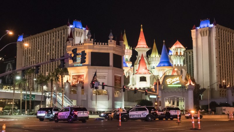 LAS VEGAS, USA - OCTOBER 02: Police block the roads leading to the Mandalay Hotel (background) after a gunman attack in Las Vegas, NV, United States on October 02, 2017. At least 50 people were killed and more than 200 others wounded at a country music concert in the city of Las Vegas late Sunday night in the deadliest mass shooting in recent U.S. history, a Nevada sheriff announced Monday. A gunman -- identified as Stephen Paddock -- opened fire on more than 10,000 concert-goers at an outdoor venue from across the Mandalay Bay Hotel at around 10.08 p.m. local time (0508GMT Monday), Clark County Sheriff Joseph Lambardo from the Las Vegas Metropolitan Police Department (LVMPD) told reporters.