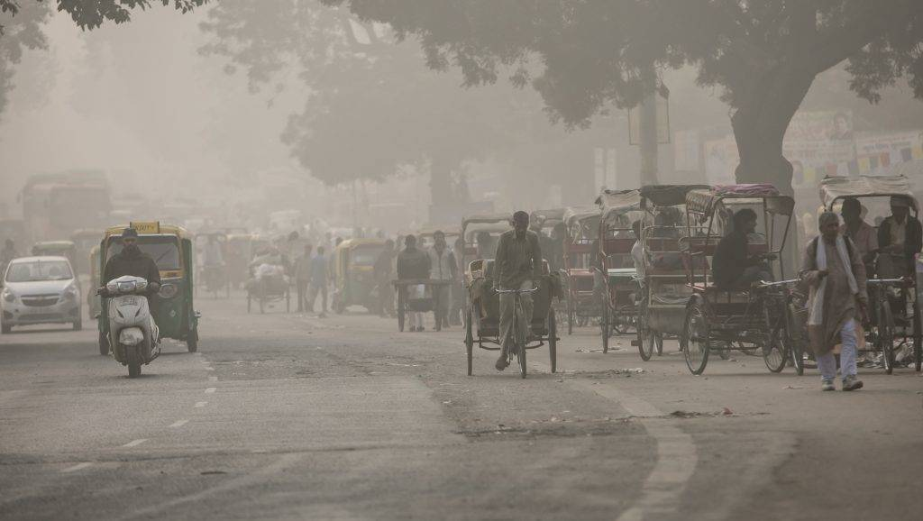 """DELHI, INDIA - NOVEMBER 7:  Traffic moves along a street amid heavy dust and smog November 7, 2016 in Delhi, India. People in India's capital city are struggling with heavily polluted air after low winds, holiday fireworks residue and crop-burning in neighboring states contribute to the haze, which has reduced visibility to 400 meters. The pollution levels have risen to 15 times more then the safe limit,  news reports said. Thousands of schools have been ordered closed, cricket matches canceled and residents warned to stay inside. The US embassy has said that it is """"very concerned"""" about the impact of the pollution on Americans living in Delhi and the public at large. (Photo by Allison Joyce/Getty Images)"""