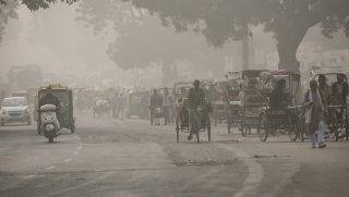 "DELHI, INDIA - NOVEMBER 7:  Traffic moves along a street amid heavy dust and smog November 7, 2016 in Delhi, India. People in India's capital city are struggling with heavily polluted air after low winds, holiday fireworks residue and crop-burning in neighboring states contribute to the haze, which has reduced visibility to 400 meters. The pollution levels have risen to 15 times more then the safe limit,  news reports said. Thousands of schools have been ordered closed, cricket matches canceled and residents warned to stay inside. The US embassy has said that it is ""very concerned"" about the impact of the pollution on Americans living in Delhi and the public at large. (Photo by Allison Joyce/Getty Images)"