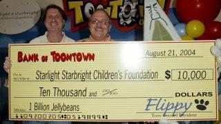 Ken Goldstein and John Moschitta Jr., executive vice president, Starlight Starbright Children's Foundation (Photo by Jesse Grant/WireImage)