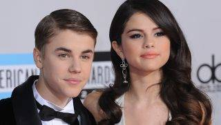 LOS ANGELES, CA - NOVEMBER 20:  Justin Bieber and Selena Gomez arrive at the 2011 American Music Awards at Nokia Theatre L.A. Live on November 20, 2011 in Los Angeles, California.  (Photo by C Flanigan/FilmMagic)