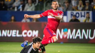CARSON, CA - MAY 6: Nemanja Nikolic #23 of Chicago Fire scores a goal as Brian Rowe #12 of Los Angeles Galaxy defends during Los Angeles Galaxy's MLS match against Chicago Fire at the StubHub Center on May 6, 2017 in Carson, California.  The match ended in a 2-2 tie.(Photo by Shaun Clark/Getty Images)