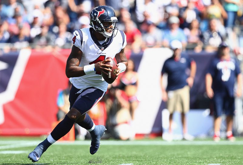 FOXBORO, MASSACHUSETTS - SEPTEMBER 24:  Deshaun Watson #4 of the Houston Texans looks to throw during the first quarter of a game against the New England Patriots at Gillette Stadium on September 24, 2017 in Foxboro, Massachusetts.  (Photo by Maddie Meyer/Getty Images)