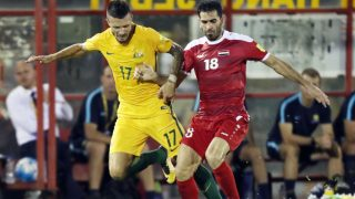 MALACCA, MALAYSIA - OCTOBER 05: Nikita Rukavytsya of Australia holds off Mhd Zaher Almedani of Syria during the 2018 FIFA World Cup Asian Playoff match between Syria and the Australia Socceroos at Hang Jebat Stadium on October 5, 2017 in Malacca, Malaysia.  (Photo by Stanley Chou/Getty Images)