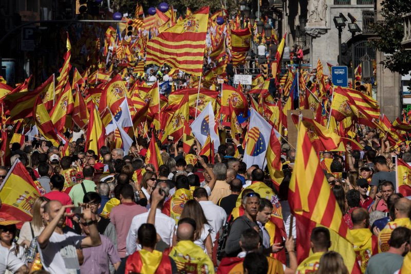 BARCELONA, SPAIN - OCTOBER 08:  Demonstrators march during a protest against Catalonia's indepedence on October 8, 2017 in Barcelona, Spain. Large number of citizens are expected to protest on Sunday in Barcelona against the indepedence movement in a march that has been organised by the Societat Civil Catalana. Catalonia's president  Carles Puigdemont will address the  Catalan Parliament on 10th October to discuss the result of the referendum that was held on October 1.  (Photo by David Ramos/Getty Images)
