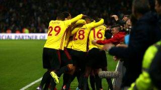 WATFORD, ENGLAND - OCTOBER 14: Watford players celebrate Tom Cleverley's late winning goal during the Premier League match between Watford and Arsenal at Vicarage Road on October 14, 2017 in Watford, England. (Photo by Charlie Crowhurst/Getty Images)